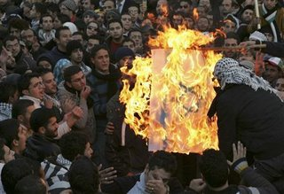 Jordanian MPs and protestors burning the Israeli flag