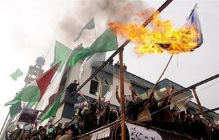 Afghan demonstrators burn an Israeli flag outside a Mosque in Kabul