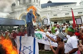 Protestors burning Israeli flag at Sultan Abu Bakar mosque, Johor Bharu